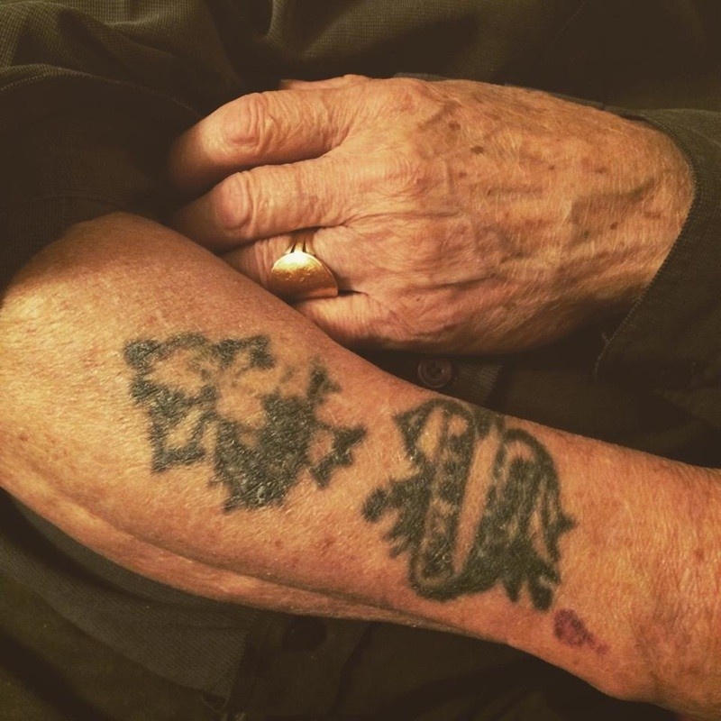 Fading tattoo on old mans arm.